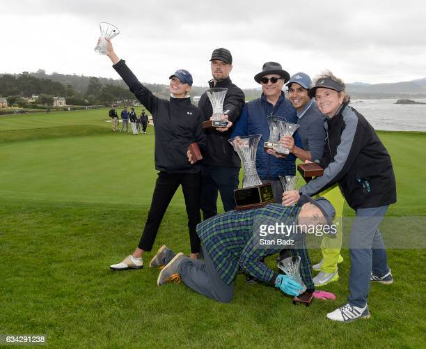 Celebrity Team Murray members Kelly Rohrbach David 'Josh' Duhamel Andy Garcia Kunal Nayyar Gary Mule Deer and Bill Murray pose with their trophies...