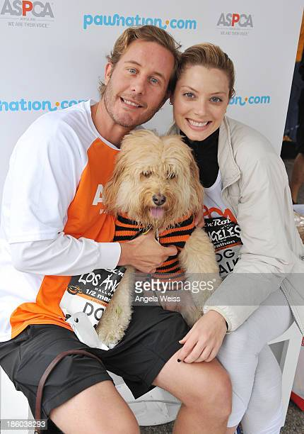 Celebrity trainer Christopher Lane actress April Bowlby and her dog Clementine attend the Rock 'n' Roll Los Angeles Halloween HalfMarathon...