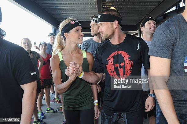 Celebrity trainers Chris Powell and Heidi Powell take on the Reebok Spartan Race in at Citi Field on April 12 2014 in New York City