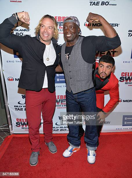 Celebrity trainers Eric The Trainer Fleischman and Billy Blanks get photobombed by boxer Victor Ortiz at Celebrity Sweat's After ESPYs VIP Bash at...