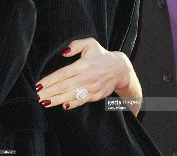 Celebrity Victoria Beckham displays her ring reportedly a 1 million USD pink diamond from Asprey's bought by her husband David for her 30th birthday...