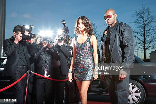 Celebrity walking from car on red carpet