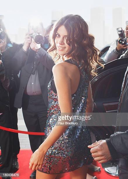 Celebrity walking on red carpet