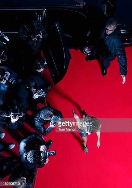 celebrity walking past paparazzi on red carpet - celebrities london stock pictures, royalty-free photos & images