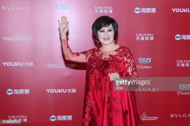 Celebrity YueSai Kan arrives at red carpet during the opening ceremony of the 21st Shanghai International Film Festival at Shanghai Grand Theatre on...