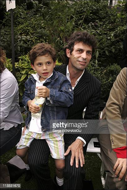Celebs At Francesco Smalto Spring Summer 2006 Fashion Show On July 4Th 2005 In Paris France Here Frederic Taddei And His Son Diego