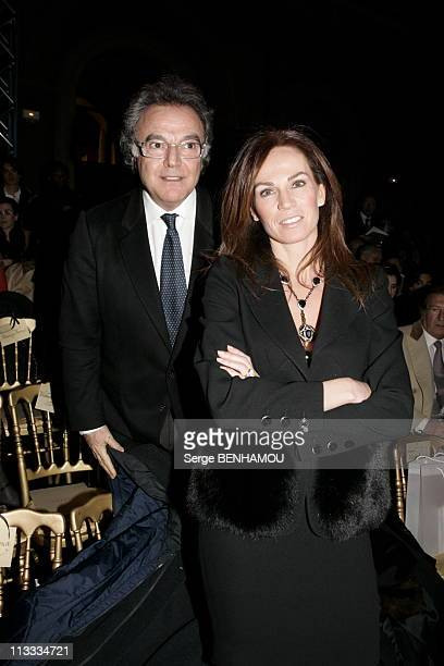 Celebs At Valentino SpringSummer 2006 Haute Couture Show In Paris On January 23Rd 2006 In Paris France Here Alain Afflelou And His Wife Rosalie