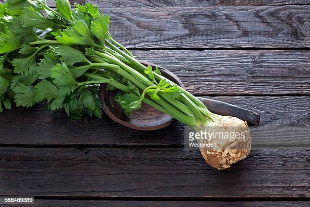 Celeriac and wooden spoon on dark wood