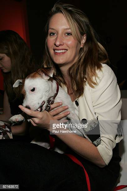 Celerie Kemble and her dog Anchovie attends the Lela Rose Fall 2005 show during Olympus Fashion Week February 9 2005 in New York City