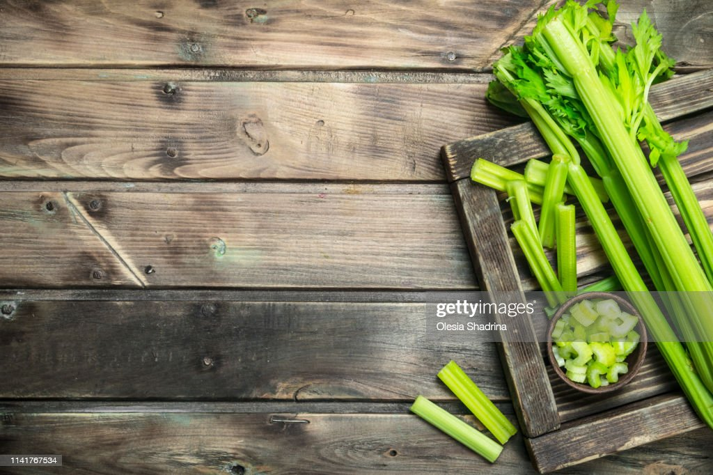 Celery on a wooden tray. : Stock Photo