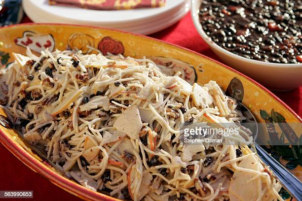 Celery root and apple slaw foreground and black beans