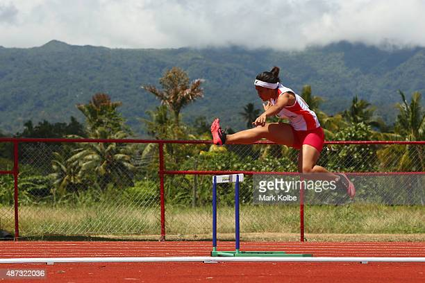 Celeste Goh of Singapore competes in the girls 400m hurdles during the athletics competition at the Apia Park Sports Complex on day three of the...