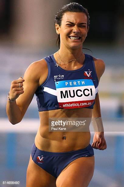 Celeste Mucci of Victoria celebrates winning the Women's 100 Metre Hurdles u20 event during the Australian Junior Athletics Championships at the WA...