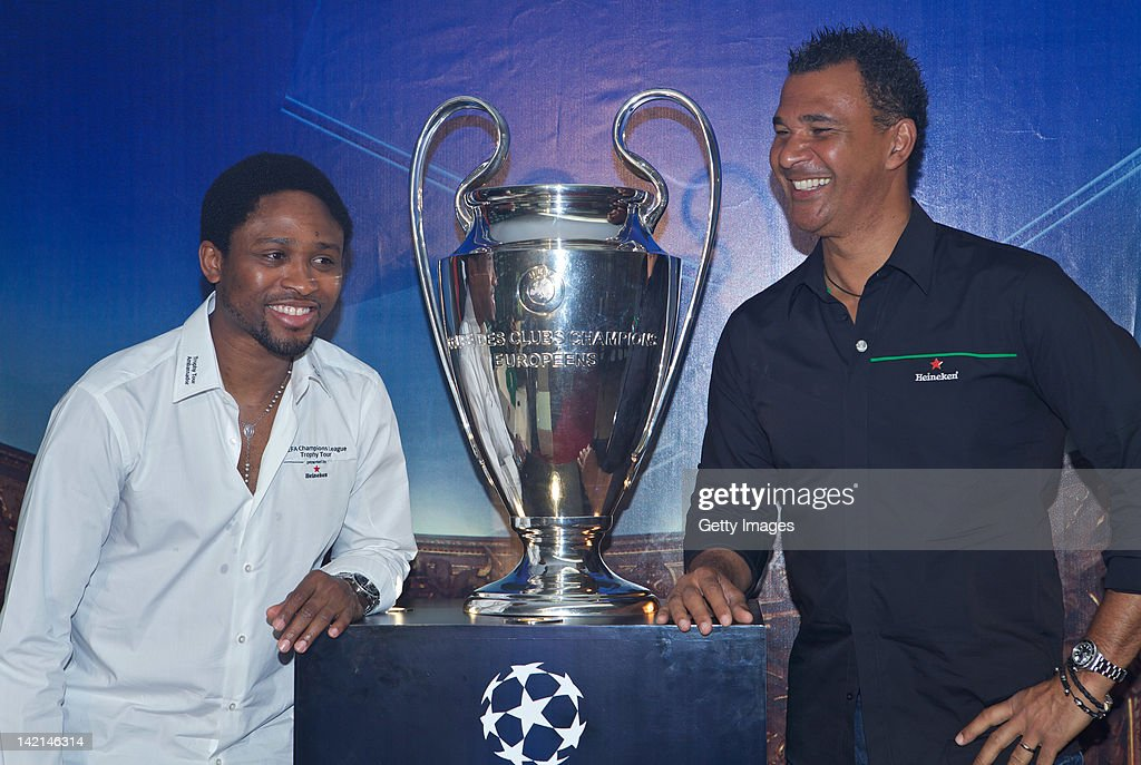 Celestine Babayaro L And Ruud Gullit Unveil The UEFA Champions League Trophy During