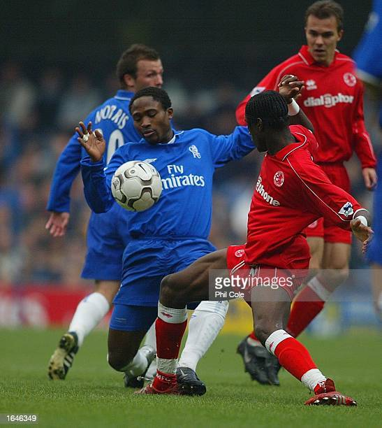 Celestine Babayaro of Chelsea gets tackled by JosephDesire Job of Middlesborough during the FA Barclaycard Premiership match between Chelsea and...
