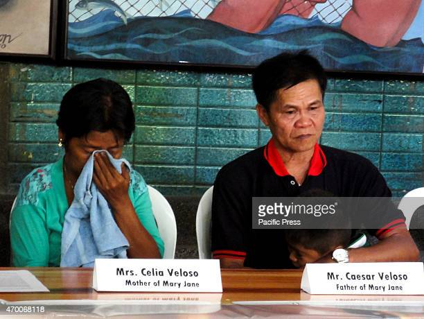 Celia and Cesar Veloso parents of convicted drug trafficker Mary Jane Veloso listen during a press conference at the University of the Philippines in...