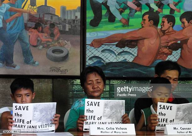 Celia and Cesar Veloso parents of convicted drug trafficker Mary Jane Veloso raise placards along with Mary Jane's children as they appeal to stop...