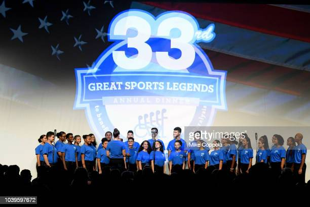 Celia Cruz Bronx High School of Music Stage Choir performs onstage during the 33rd Annual Great Sports Legends Dinner which raised millions of...