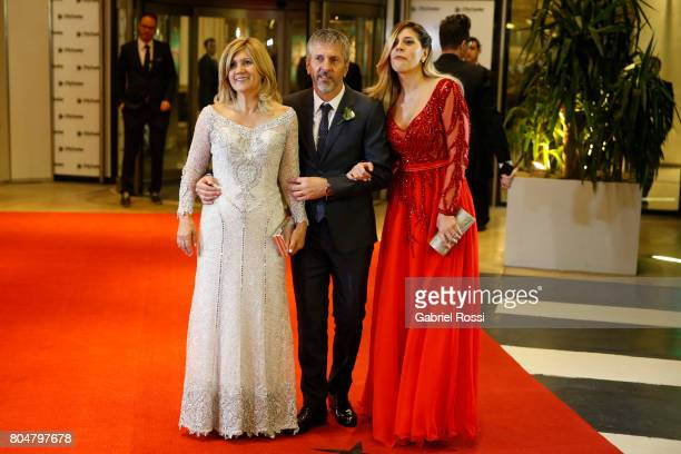 Celia Cuccittini Messi Jorge Messi and Maria Sol Messi pose for pictures on the red carpet during Lionel Messi and Antonela Rocuzzo's Wedding at City...