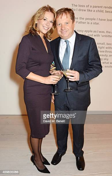 """Celia Dunstone and Sir Charles Dunstone attend a private view of """"And The Stars Shine Down"""" by Stasha Palos at the Saatchi Gallery on December 2,..."""