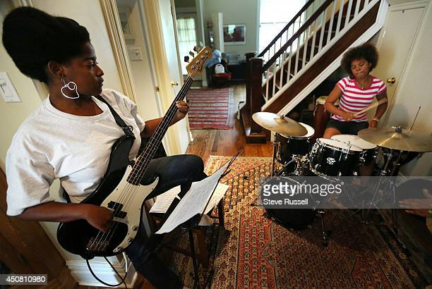 TORONTO ON JUNE 14 Celia Jimenez plays Bass as Yissy Garcia plays drums Saxophone player Jane Bunnett and her allgirl Cuban band rehearse for their...