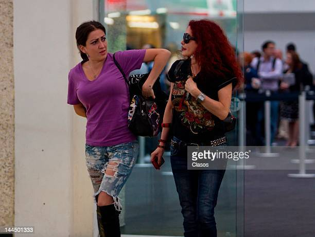 Celia Lora and Chela Lora walk in the terminal 2 of the international airport Benito Juarez on May 11 2012 Mexico City Mexico