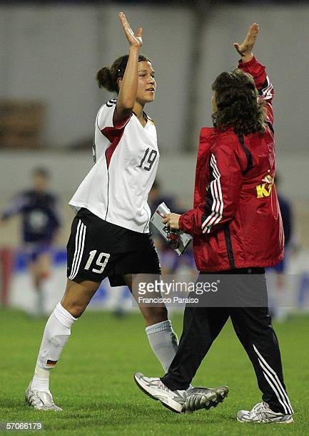 Celia Mbabi of Germany celebrates with an unnamed German staff member during the Womens Algarve Cup match between Germany and Sweden on March 11,...