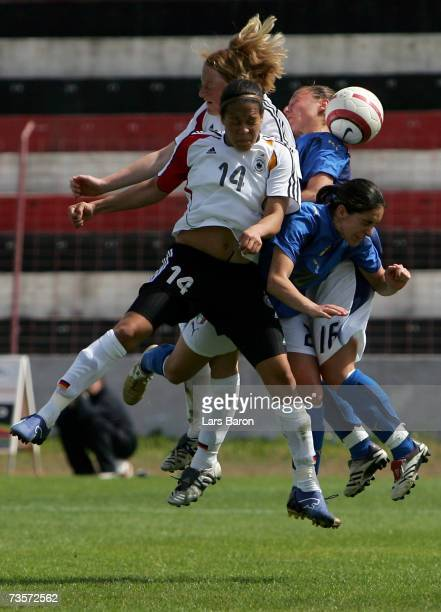 Celia Okoyino da Mbabi and Melanie Baehringer of Germany go up for a header with Cristina Cassanelli and Silvia Fuselli of Italy during the Algarve...