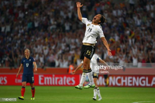 Celia Okoyino da Mbabi dd celebrates her team's fourth goal during the FIFA Women's World Cup 2011 Group A match between France and Germany at the...
