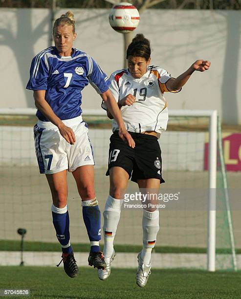 Celia Okoyino da Mbabi of Germany and Anne Makinen of Finland battle for the ball during the Womens Algarve Cup match between Germany and Finland on...