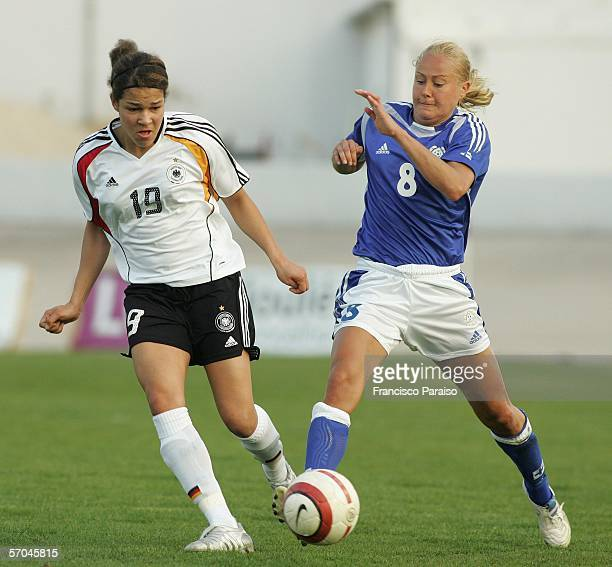 Celia Okoyino da Mbabi of Germany and Minna Mustonen of Finland battle for the ball during the Womens Algarve Cup match between Germany and Finland...