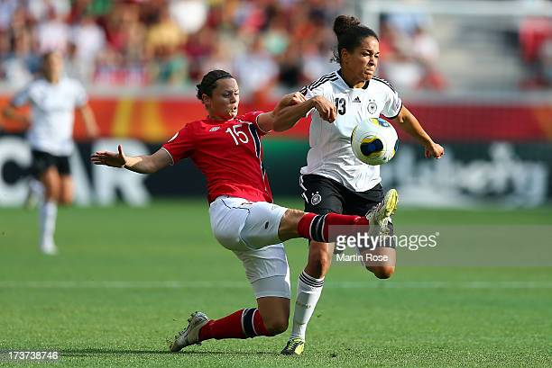Celia Okoyino Da Mbabi of Germany and Nora Holstad Berge of Norway battle for the ball during the UEFA Women's Euro 2013 group B match between...