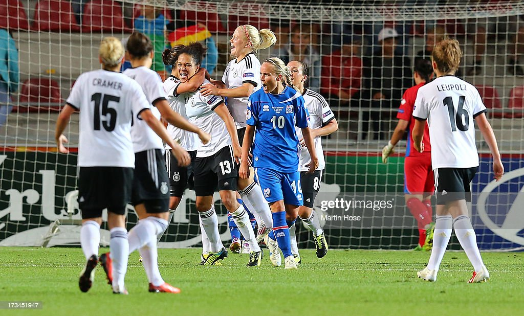 Celia Okoyino Da Mbabi (#13) of Germany celebrate with her team mates after she scores her team's 2nd goal during the UEFA Women's Euro 2013 group B match between Iceland and Germany at Vaxjo Arena on July 14, 2013 in Vaxjo, Sweden.