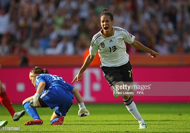 Celia Okoyino da Mbabi of Germany celebrates after scoring the second goal during the FIFA Women's World Cup Group A match between Germany and Canada...
