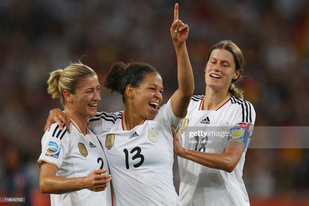 Celia Okoyino da Mbabi (C) of Germany celebrates her team's fourth goal with team mates Bianca Schmidt (L) and Kerstin Garefrekes during the FIFA Women's World Cup 2011 Group A match between France and Germany at the Fifa Womens World Cup Stadium on July 5, 2011 in Moenchengladbach, Germany.