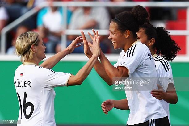 Celia Okoyino da Mbabi of Germany celebrates her team's second goal with team mates Martina Mueller and Fatmire Bajramaj during the International...