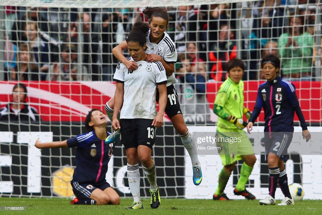 Celia Okoyino da Mbabi (front) of Germany celebrates her team's third goal with team mate Fatmire Bajramaj during the Women's International Friendly match between Germany and Japan at Allianz Arena on June 29, 2013 in Munich, Germany.