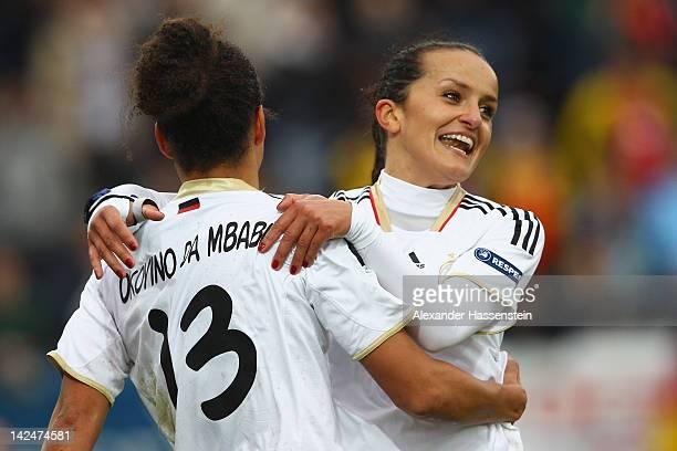 Celia Okoyino da Mbabi of Germany celebrates scoring the opening goal with her team mate Fatmire Bajrama during the UEFA Women's EURO Qualifier...