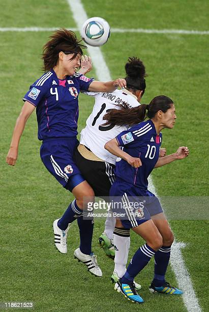 Celia Okoyino Da Mbabi of Germany heads for the ball with Saki Kumagai and Homare Sawa of Japan during the FIFA Women's World Cup quarter finals...