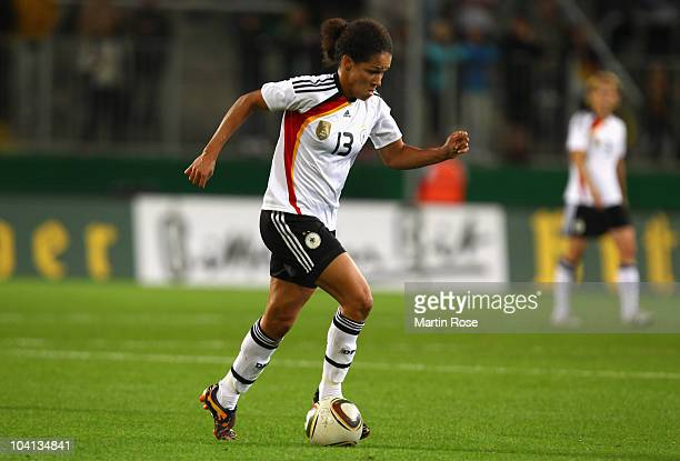 Celia Okoyino Da Mbabi of Germany runs with the ball during the Women's International Friendly match between Germnay and Canada at Rudolf Harbig...