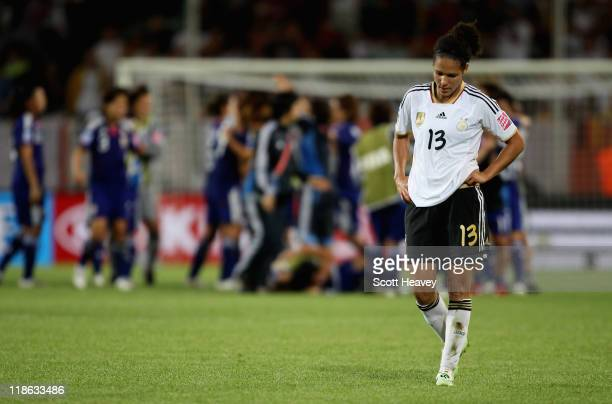 Celia Okoyino Da Mbabi of Germanylooks dejected after defeat in the FIFA Women's World Cup 2011 Quarter Final match between Germany and Japan at...