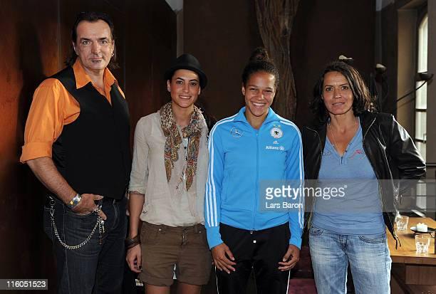 Celia Okoyino da Mbabi poses with actor Andreas Hoppe actress Filiz Koc and actress Ulrike Folkerts during the German Women National Team Tatort...