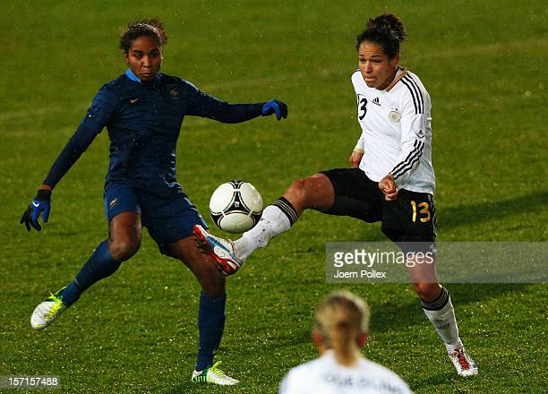 Celia Okoyino of Germany and Laura Georges of France compete for the ball during the Women's International Friendly match between Germany and France...