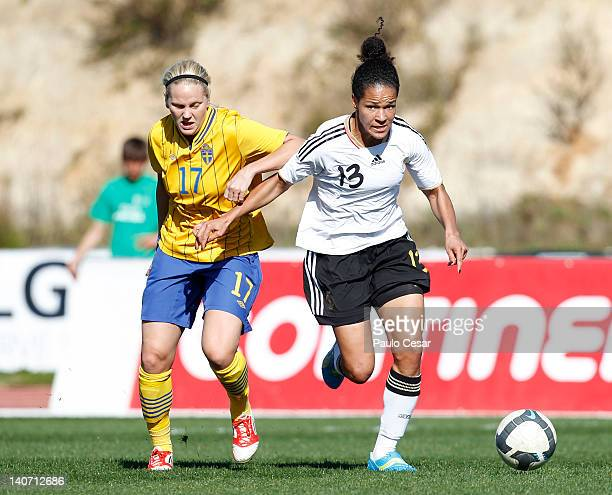 Celia Okoynoda Mbabi of Germany challenges Lisa Dhalkvist of Sweden during the Women Algarve Cup match between Germany and Sweden on March 5, 2012 in...