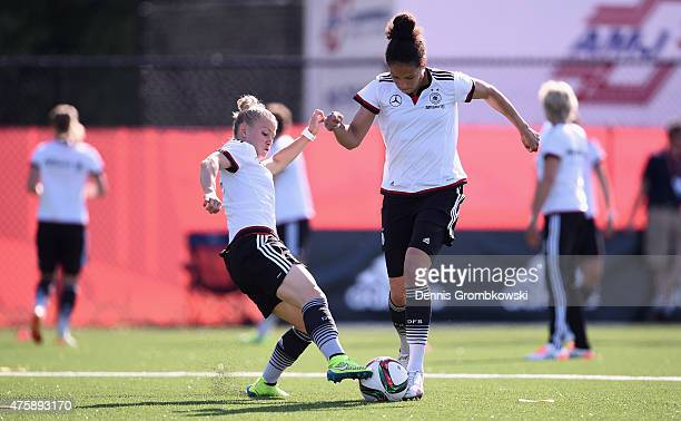Celia Sasic and Leonie Maier of Germany battle for the ball during a training session at Richcraft Recreation Complex on June 4, 2015 in Ottawa,...