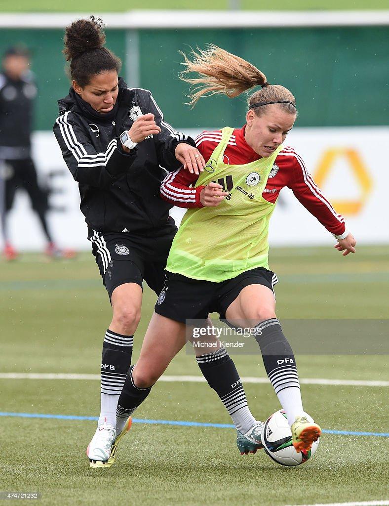 Celia Sasic (L) challenges Lena Petermann during the German National Women's team training on May 25, 2015 in Wollerau, Switzerland.