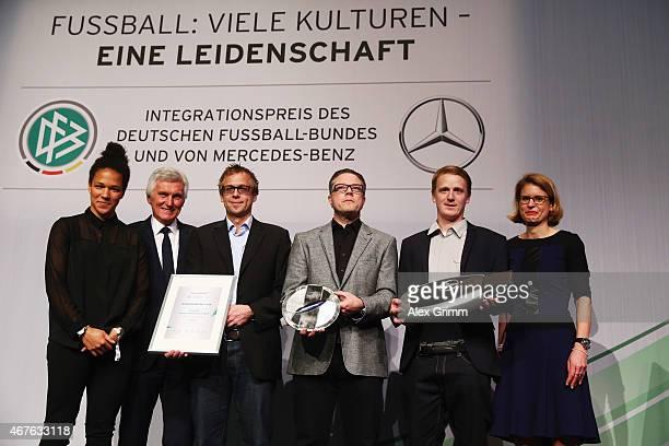 Celia Sasic DFB Vice President Eugen Gehlenborg and Laura Tilly head of Global Diversity Office Daimler AG pose with representatives of Sportkreis...