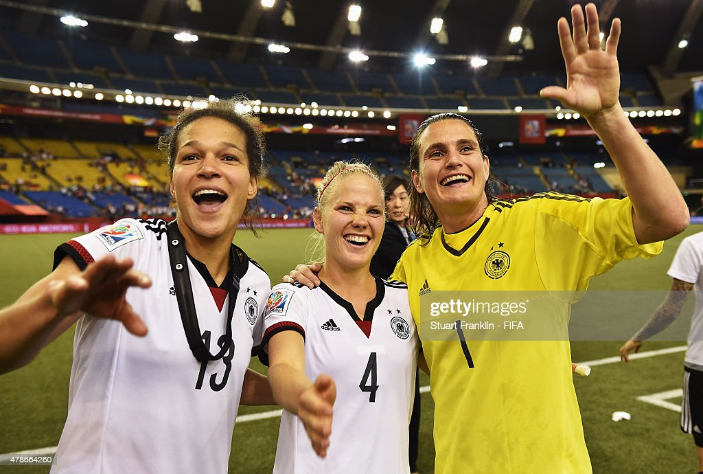 Celia Sasic, Leonie Maier and Nadine Angerer of Germany celebrate winning the quarter final match of the FIFA Women's World Cup between Germany and France at Olympic Stadium on June 26, 2015 in Montreal, Canada.