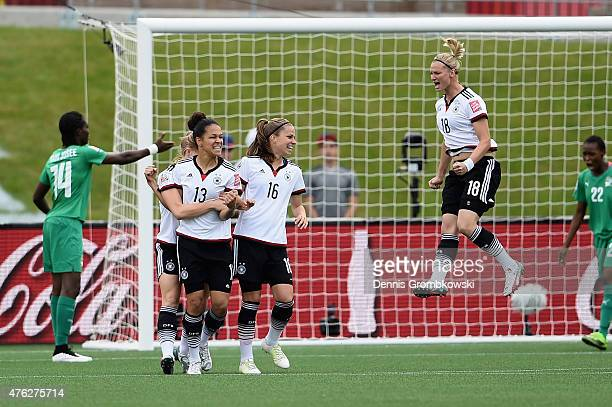Celia Sasic of Germany celebrates as she scores the first goal during the FIFA Women's World Cup Canada 2015 Group B match between Germany and Cote...