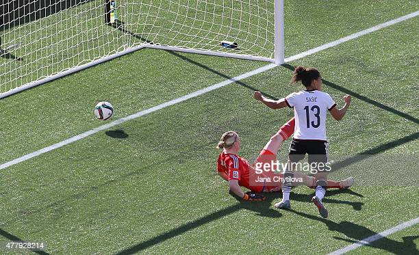 Celia Sasic of Germany celebrates her second goal against Hedvig Lindahl of Sweden during the FIFA Women's World Cup Canada 2015 round of 16 match...